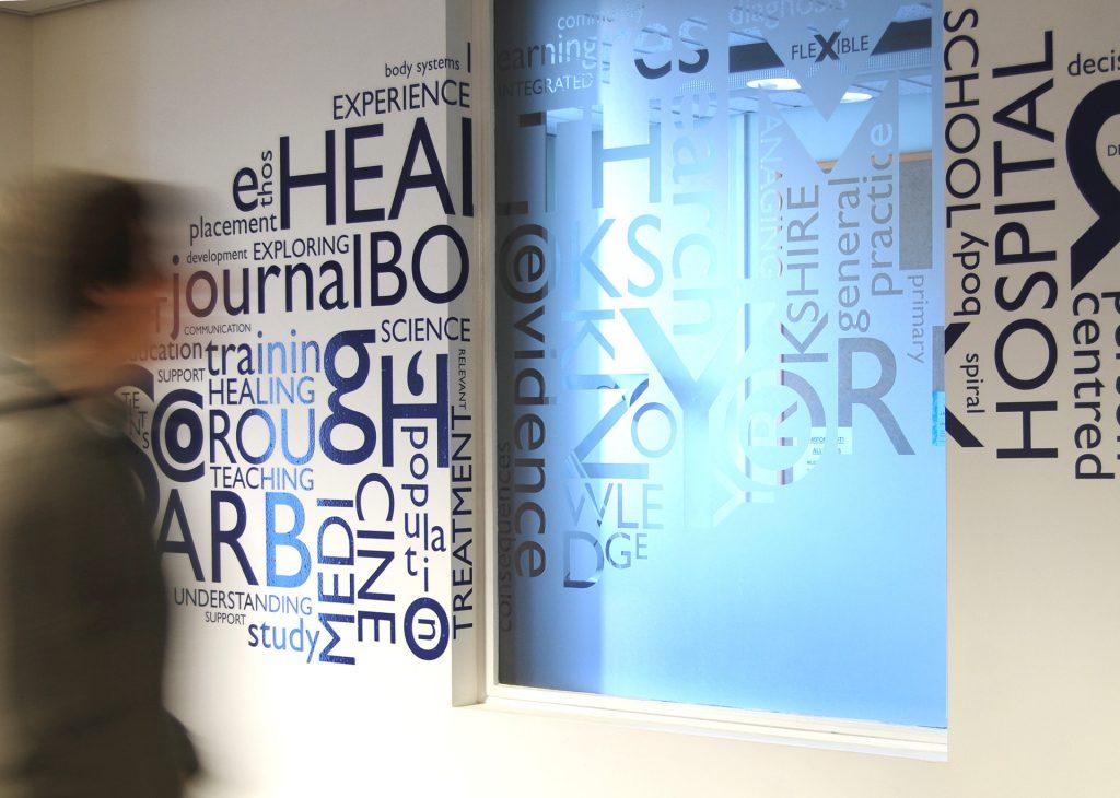 wall of words at hull & york medical school. [hull & york medical school / york NHS hospital arts]